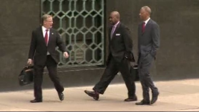 Bobby Ferguson outside court with attorneys