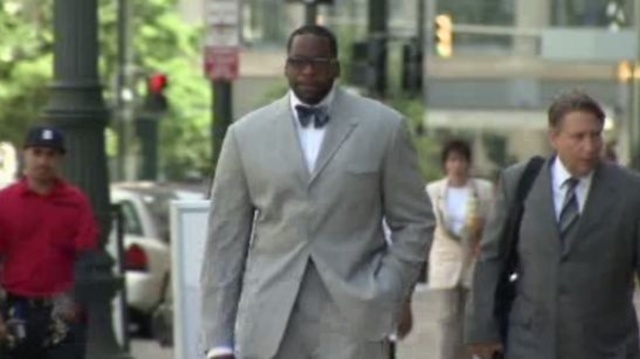 Kwame Kilpatrick outside court with defense team
