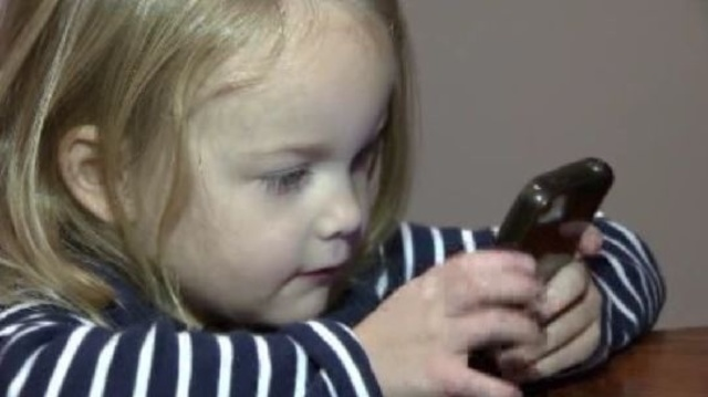 Ava with phone
