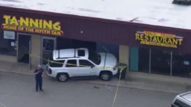Woman hit as out of control suv slams into tanning salon in for 360 tanning salon