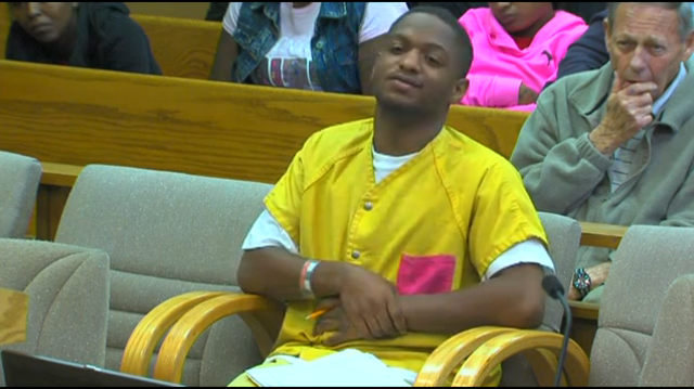 Raymone Jackson smiling in court