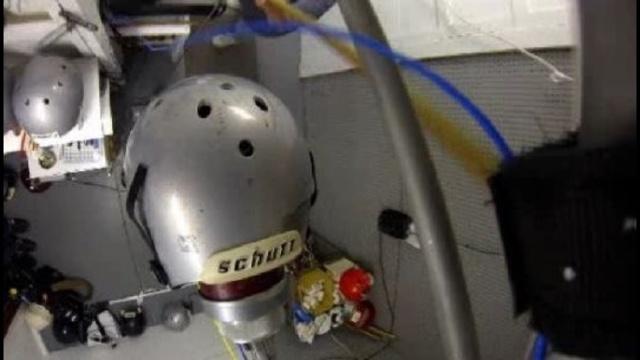 football helmet being worked on
