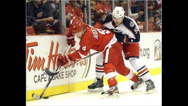 Red Wings Justin Abdelkader battles Blue Jackets defenseman David Savard