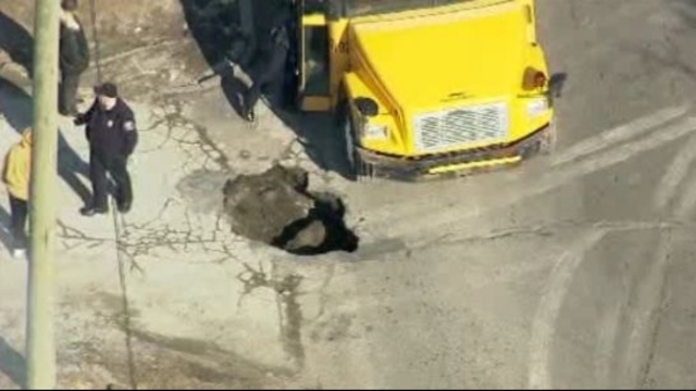 Bus stuck in pothole Detroit 2