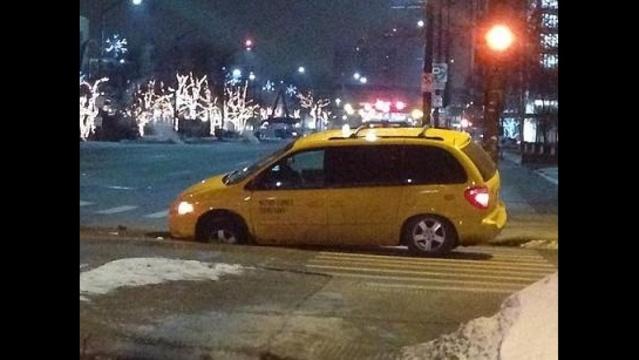 Cab in sinkhole on WB Jefferson