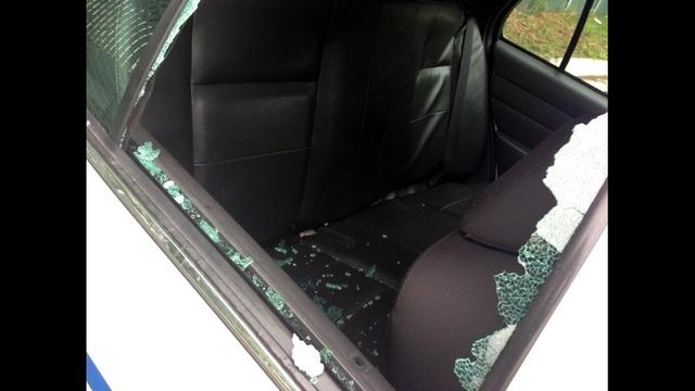 DPD patrol car damaged window