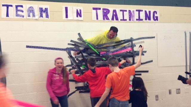 Duct taping assistant principal to wall 1