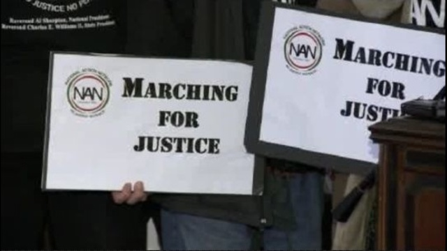 Marching for justice sign