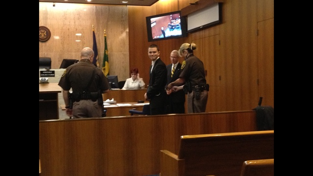 Mitchell Young smiles in court_20553150