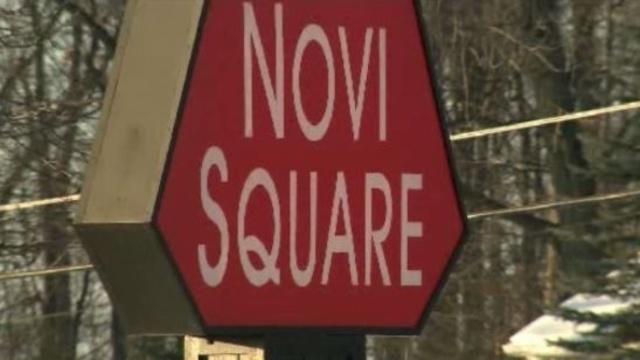 Novi Square Plaza sign