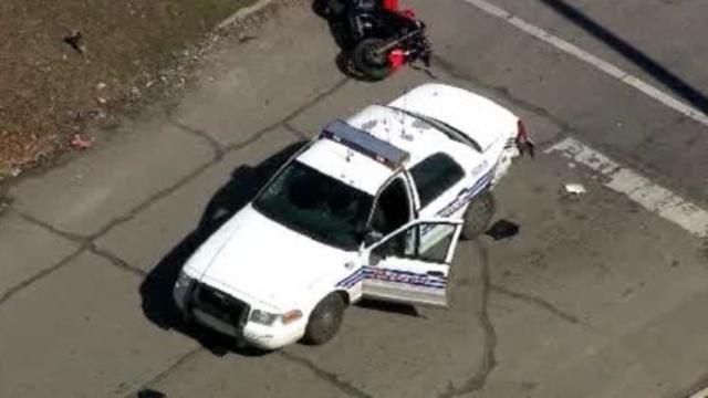 Police car motorcycle crash Detroit 2