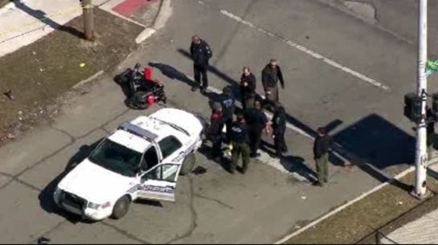 Police car motorcycle crash Detroit 3