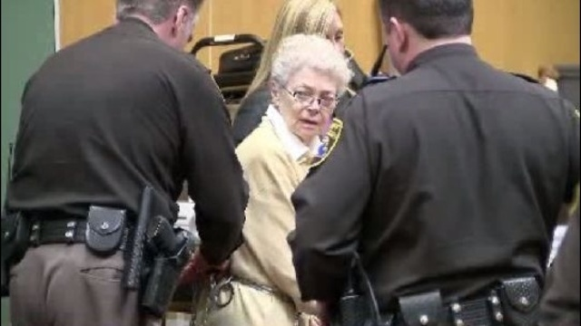 Sandra Layne being led out of court in shackles