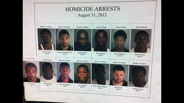 homicide carjacking arrest poster