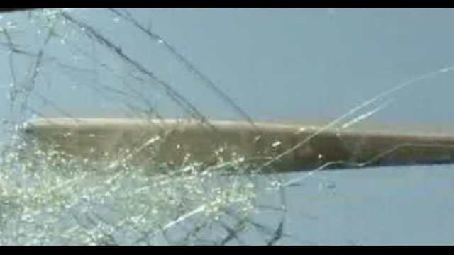 Baseball bat to windshield