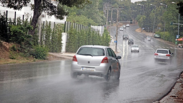 Cars driving on wet roads