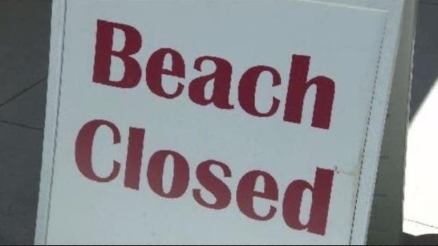 Lake Huron beach closed sign