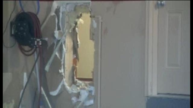 Shelb twp smashed wall scene