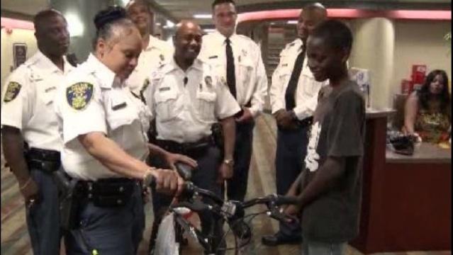 Sinai-Grace-security-gives-boy-bike.jpg_21406264