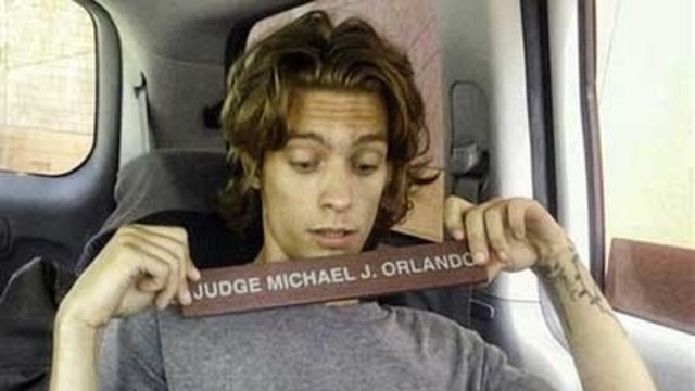 Steven Mulhall with stolen judge's sign