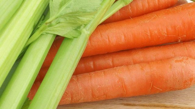 carrots and celery on cutting board, vegetables