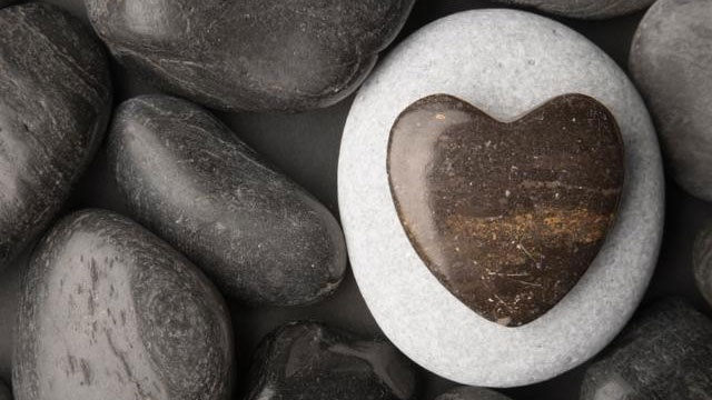 heart-shaped pebble among other rocks