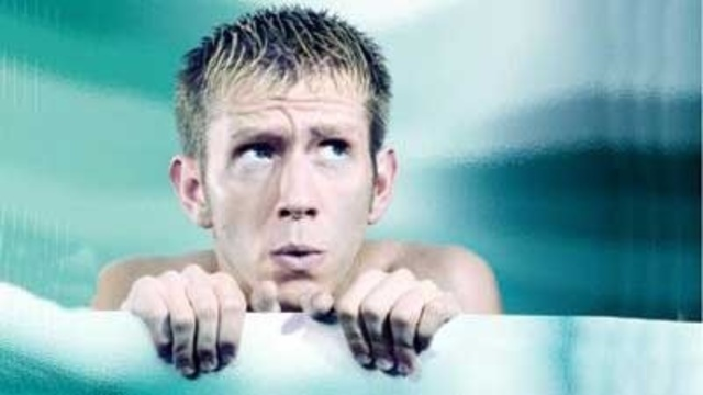 shivering cold man swimming bathing in tub