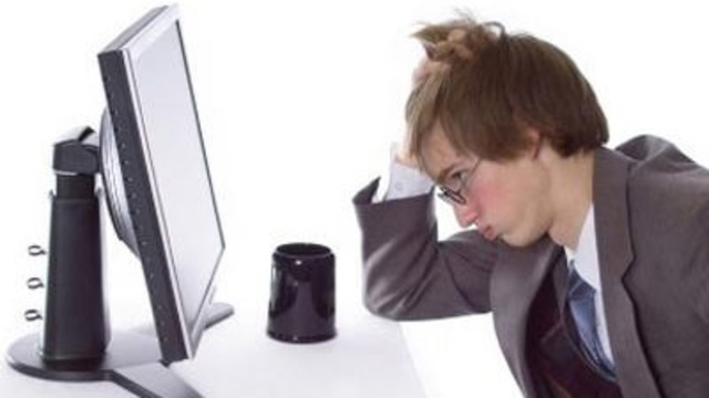 upset office worker at computer