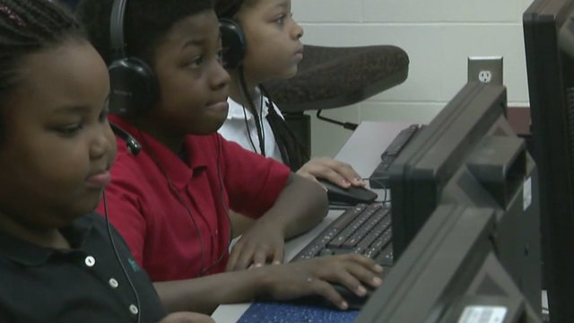 Students use computers at Gompers Elementary-Middle School in Detroit.