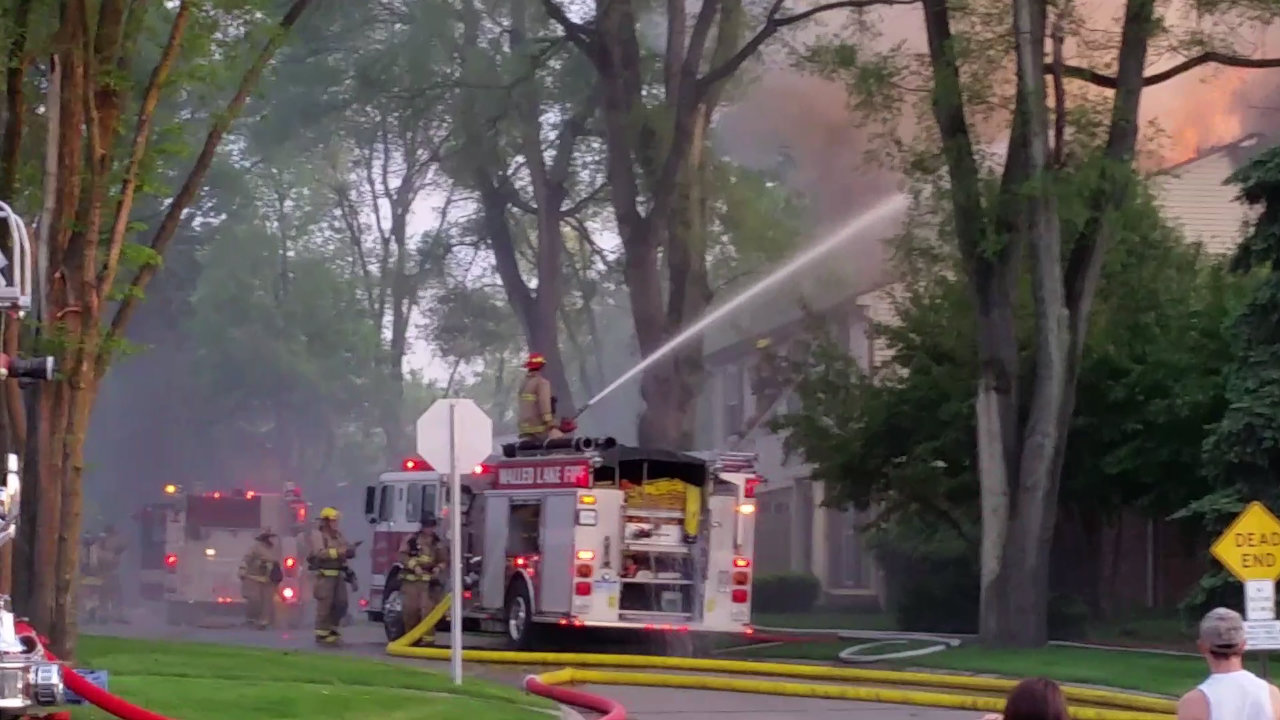 Firefighters work to put out flames at Walled Lake condominiums