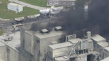 LIVE: Fire burns at cement company in Detroit