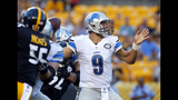 Ravens get back Flacco, lose Watson in 30-9 rout of Lions