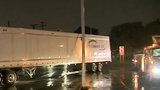 Driver trapped in truck after crashing into live wires in Detroit
