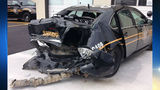 Teen crashes into police car, injures officer while 'plugging in cellphone'
