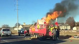 Grinch lights Christmas float on fire with cigarette butt