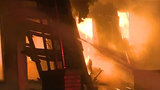 81-year-old Detroit woman's home damaged from fire at vacant house next door
