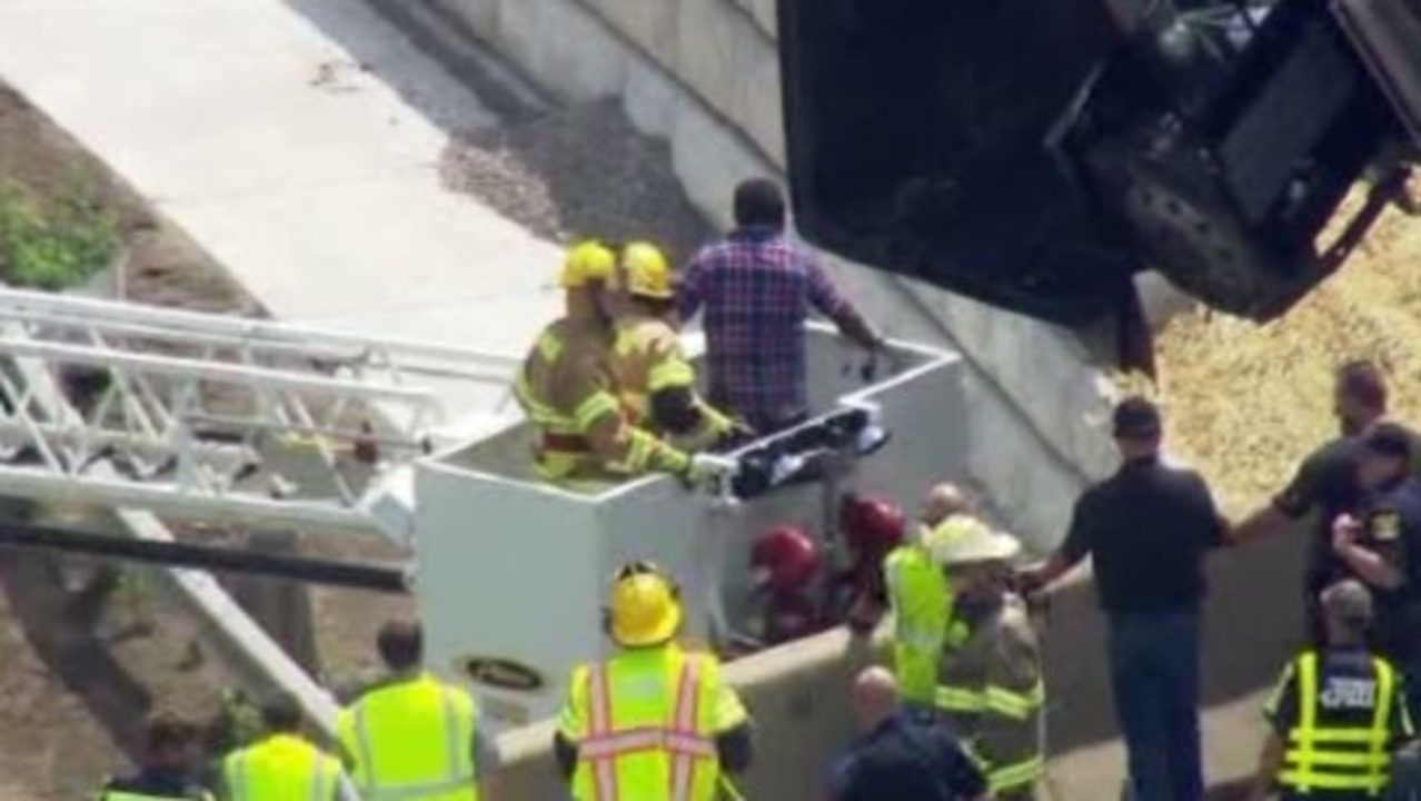 Raw video: Driver rescued from semi-truck on I-94