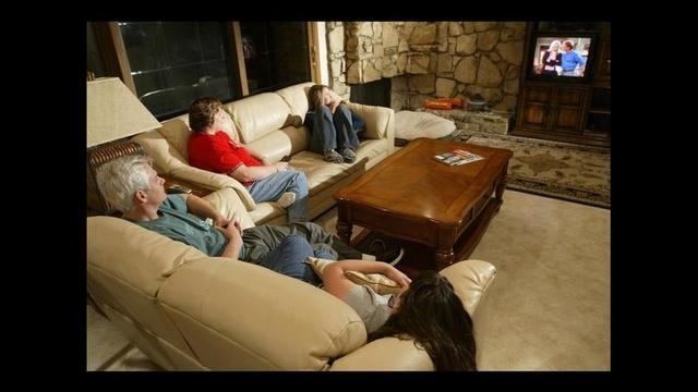 Family-watching-TV.jpg_18497742