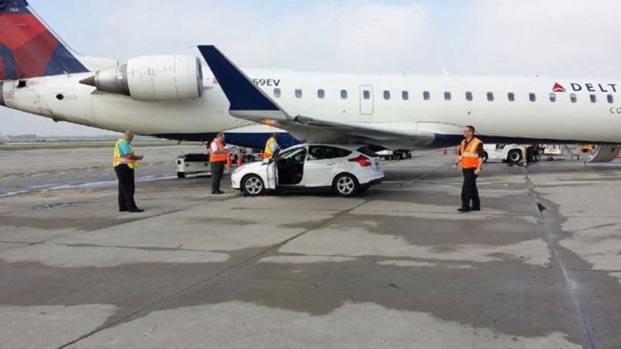Plane Runs Into Car On Tarmac At Detroit Metro Airport