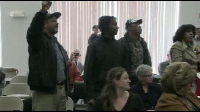 Protestors-inside-review-team-meeting.jpg_9704896