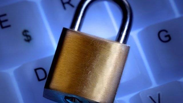 lock on computer keyboard online safey crime_4804374