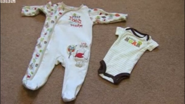 Clothes-George-is-wearing-compared-to-newborn-size.jpg_19505094