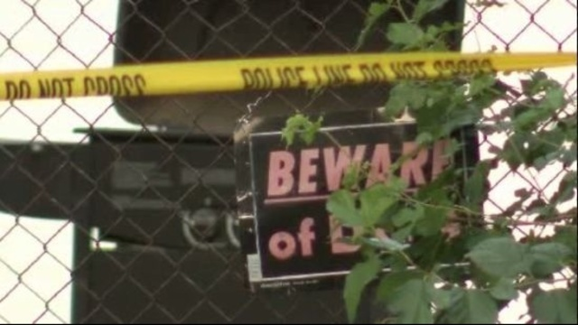 beware of dog sign -- detroit baby attacked killed_16865638