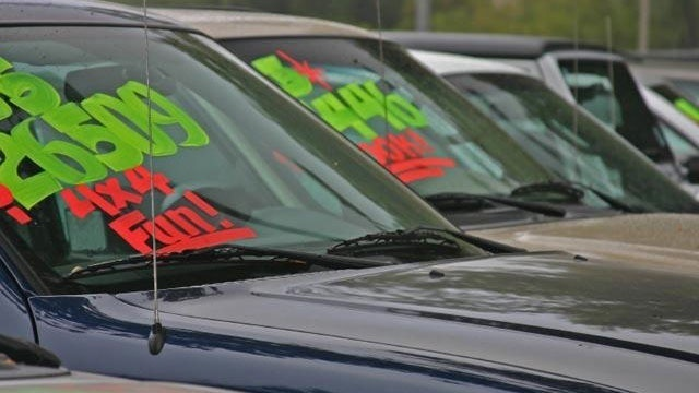 cars and trucks for sale at dealership lot