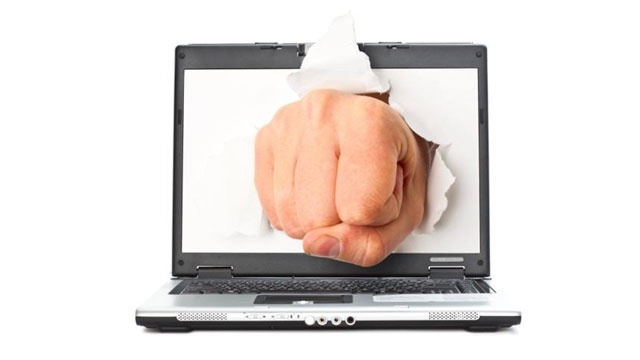 fist punching through laptop computer