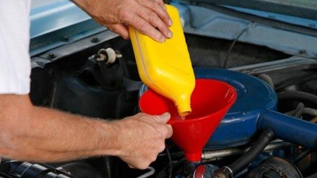 man doing oil change on car