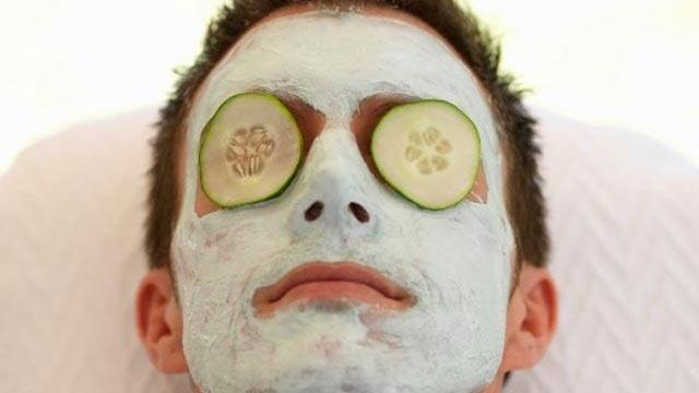 man getting facial at spa