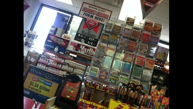 Lapeer Sunoco gas station lottery stand_16151446