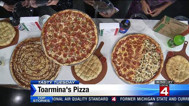 Check out the size of the pies at Toarmina's Pizza