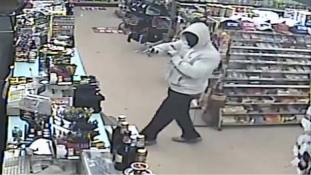 Armed robber with gun image
